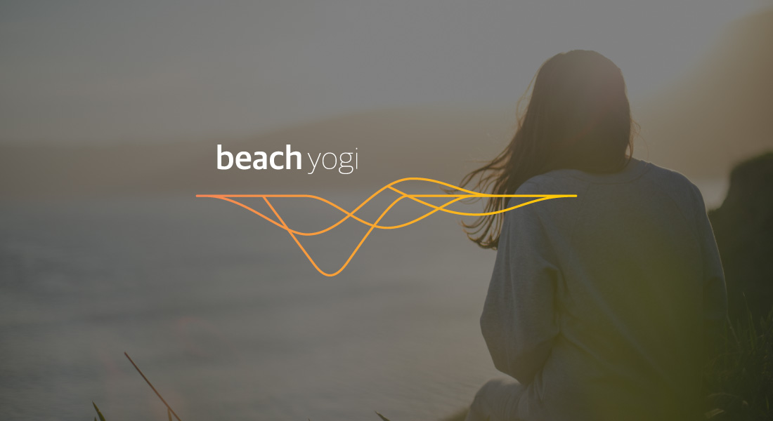 Adventure Yogi Beach Logo with a woman watching the sun set over the ocean in the background