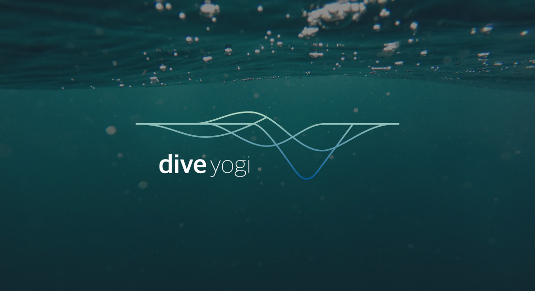 Adventure Yogi Dive Logo with an underwater photo in the background