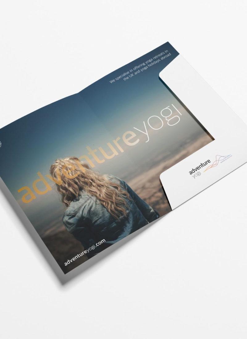 Adventure Yogi Folder featuring a blonde woman wearing a denim jacket looking over a mountainous landscape