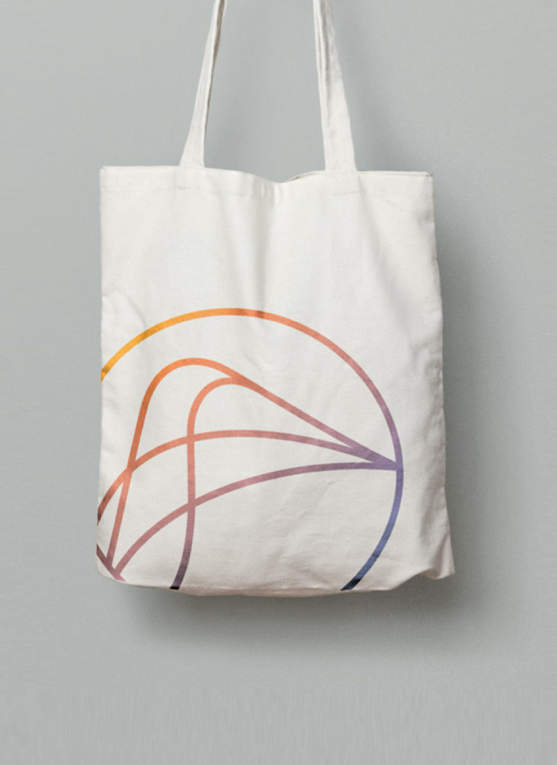Adventure Yogi logo on a cream canvas Tote bag
